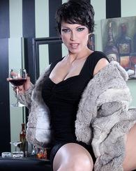 Brunette babe Nicki Hunter showing her pussy.