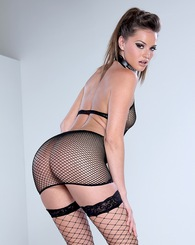Tori Black poses and strips off her fishnet stockings and undies