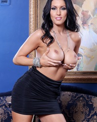 Busty brunette Dylan Ryder takes her clothes off.