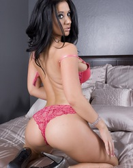 Busty brunette, Jayden Jaymes, looks like a dream in her sexy pink bra and panties and even better stripping them off and showing off her sexy clit pi