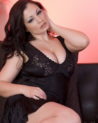 Aria Giovanni looks sweet and sassy in her little black dress, and is even hotter showing off her amazing tits and body out of her dress!