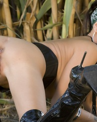 Sexy brunette pornstar, Jessica Jaymes, shows off her gorgeous big tits and amazing body outside in the field.