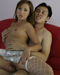 Asian hottie Tia Tanaka in white fishnet thigh highs gets pounded from behind and a takes cum load to a face.