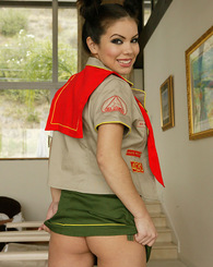Looking sexy in her girls scout uniform, and taunting you with her skills at giving head